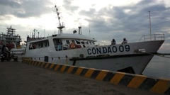 White ship moored to dock in the harbor, awaiting departure to Con Dao island. Stock Footage