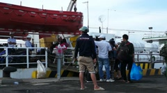 People boarding the ship to Con Dao island in the harbor of Vung Tau, Vietnam Stock Footage
