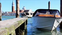 In Venice Lagoon: Small boat bobbing up and down Stock Footage