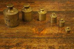 Different vintage brass weights unit Stock Photos