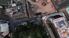 Flying Over A Construction Site and Cranes in Urban City Town with Buildings Stock Footage
