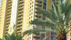 Yellow buildings and green palm trees Stock Footage