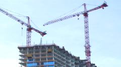 Cranes over a highrise development Stock Footage