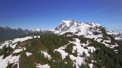 Summer Aerial of Mt Baker Ski Resort with Mt Shuksan Background Stock Footage