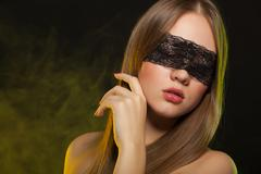 Beautiful young girl in the mask Stock Photos