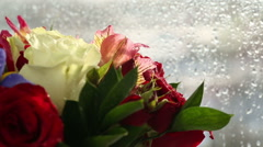 Beautiful bouquet roses, iris and alstroemeria quickly rotating Stock Footage