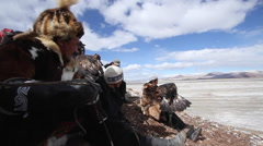 GOLDEN EAGLE HUNTER FESTIVAL BLUE SKY SNOW MOUNTAINS Stock Footage