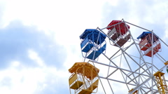 Ferris wheel rotating with sky background Stock Footage