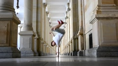 Young breakdancer dancing on the street in Karlovy vary, Czech Republic Stock Footage