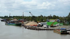 Port at Mekong River. Cranes working, loading and unloading ships and truck. Stock Footage