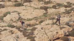 Palestinian Kids throwing stones on Israeli forces Stock Footage
