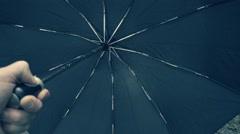 Closing the black automatic umbrella when rain stops. Slow mo, slo mo Stock Footage