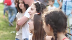 Cute little kid girls spectators fans by open air concert stage enjoy singing Stock Footage