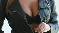 Sexy girl shows her breasts - stock footage