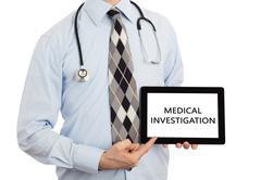 Doctor holding tablet - Medical investigation - stock photo