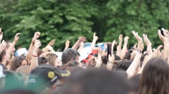 Spectators people crowd waving hands above heads enjoying open air music concert Stock Footage
