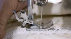 Close up on a sewing machine showing process Stock Footage
