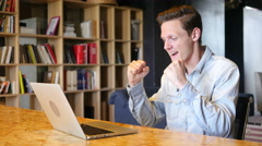 Succesful young man in office Stock Footage