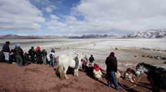 GOLDEN EAGLE HUNTER FESTIVAL SPECTATORS TOURISTS SNOW MOUNTAINS BLUE SKY VIEW Stock Footage