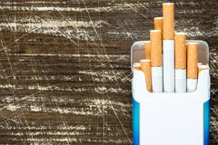 Open pack of cigarettes close-up. Stock Photos