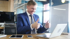 Confident and attractive businessman holding online meeting in his office. Stock Footage