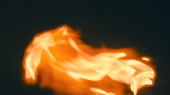 Spurts of flame  on a black background.  Slow mo, slo mo Stock Footage