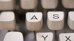 Male finger typing letter A on old, retro typewriter. - stock footage