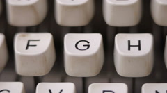 Male finger typing letter G on old, retro typewriter. Stock Footage
