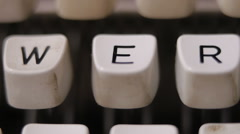 Male finger typing letter E on old, retro typewriter. Stock Footage