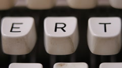 Male finger typing letter R on old, retro typewriter. - stock footage