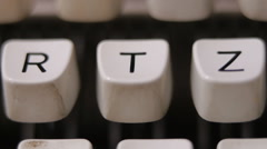 Male finger typing letter T on old, retro typewriter. - stock footage