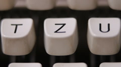 Male finger typing letter Z on old, retro typewriter. Stock Footage