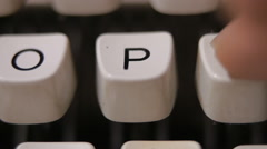 Male finger typing letter P on old, retro typewriter. - stock footage