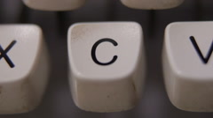 Male finger typing letter C on old, retro typewriter. - stock footage