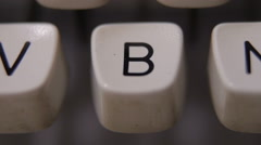 Male finger typing letter B on old, retro typewriter. Stock Footage
