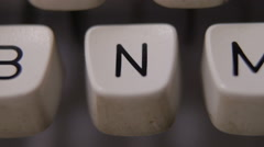 Male finger typing letter N on old, retro typewriter. - stock footage