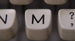Male finger typing letter M on old, retro typewriter. Stock Footage