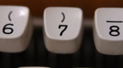 Typing number 7 on old, retro typewriter Stock Footage