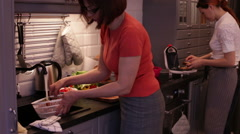 Women Cook in the Kitchen - stock footage