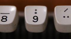 Finger typing number 9 on old, retro typewriter Stock Footage
