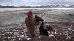 GOLDEN EAGLE HUNTER FESTIVAL BLUE SKY SNOW MOUNTAINS FLYING - stock footage