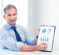 businessman showing graphs and charts - stock photo