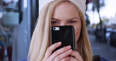 Close-up of young blond woman window shopping vintage shop Stock Footage