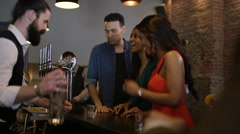 4K Bartender pouring shots for group of friends partying in city bar Stock Footage