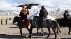 GOLDEN EAGLE HUNTER FESTIVAL HORSEMEN GHER YURT Stock Footage
