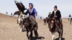 GOLDEN EAGLE HUNTER FESTIVAL HORSEMEN Stock Footage