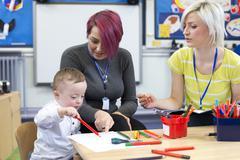 Down Syndrome boy at Nursery Stock Photos