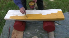 Man painting wooden bench Stock Footage