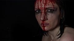 4k shoot of a horror Halloween model - Sad girl bleeding being hurt - stock footage