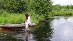 Girl on lake log relaxing - stock footage